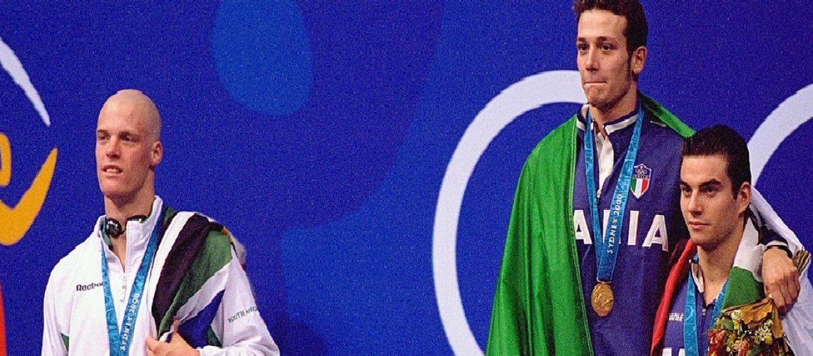 Terence Parkin sul podio dei 200 rana a Sidney 2000, con Domenico Fioravanti e Davide Rummolo.